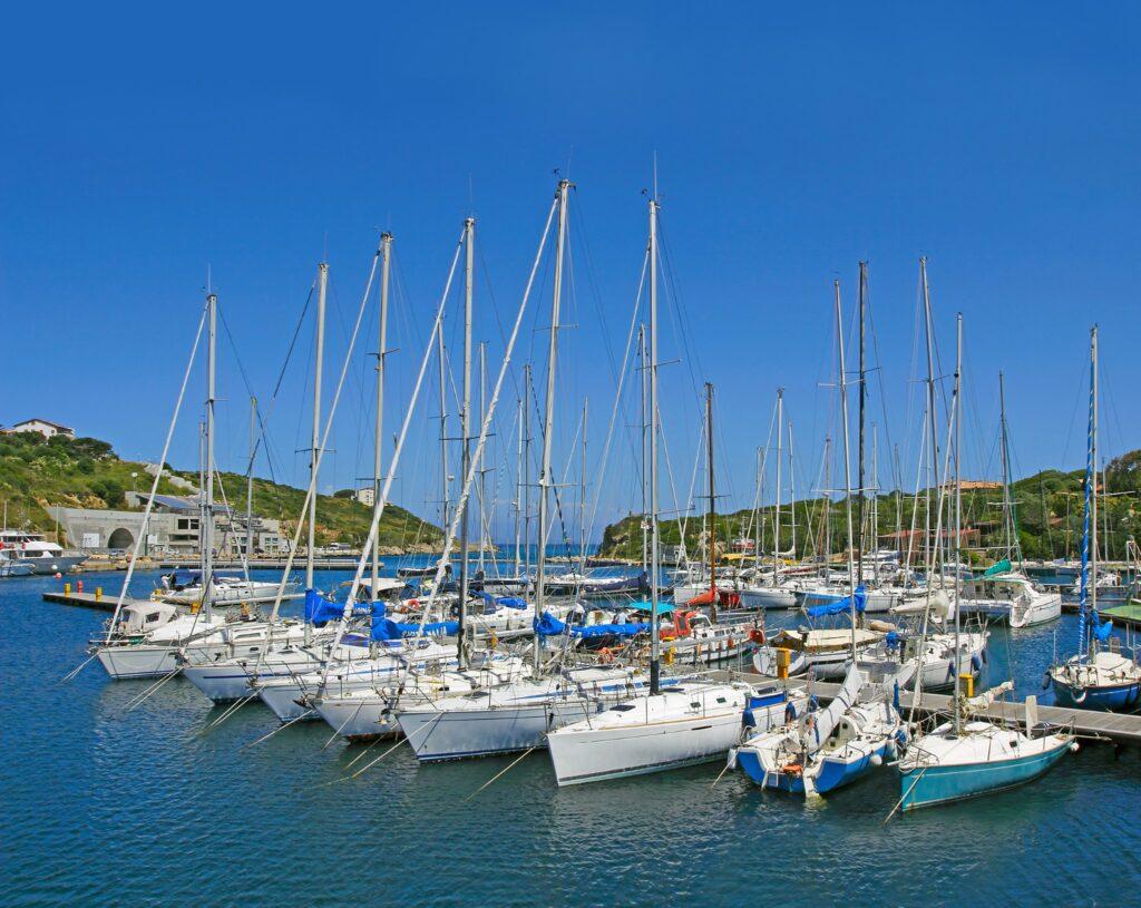 """Yachts anchored at the Marina di Santa Teresa di Gallura in the north of Sardinia, Italy -  """"Costa Smeralda"""" tourist area."""
