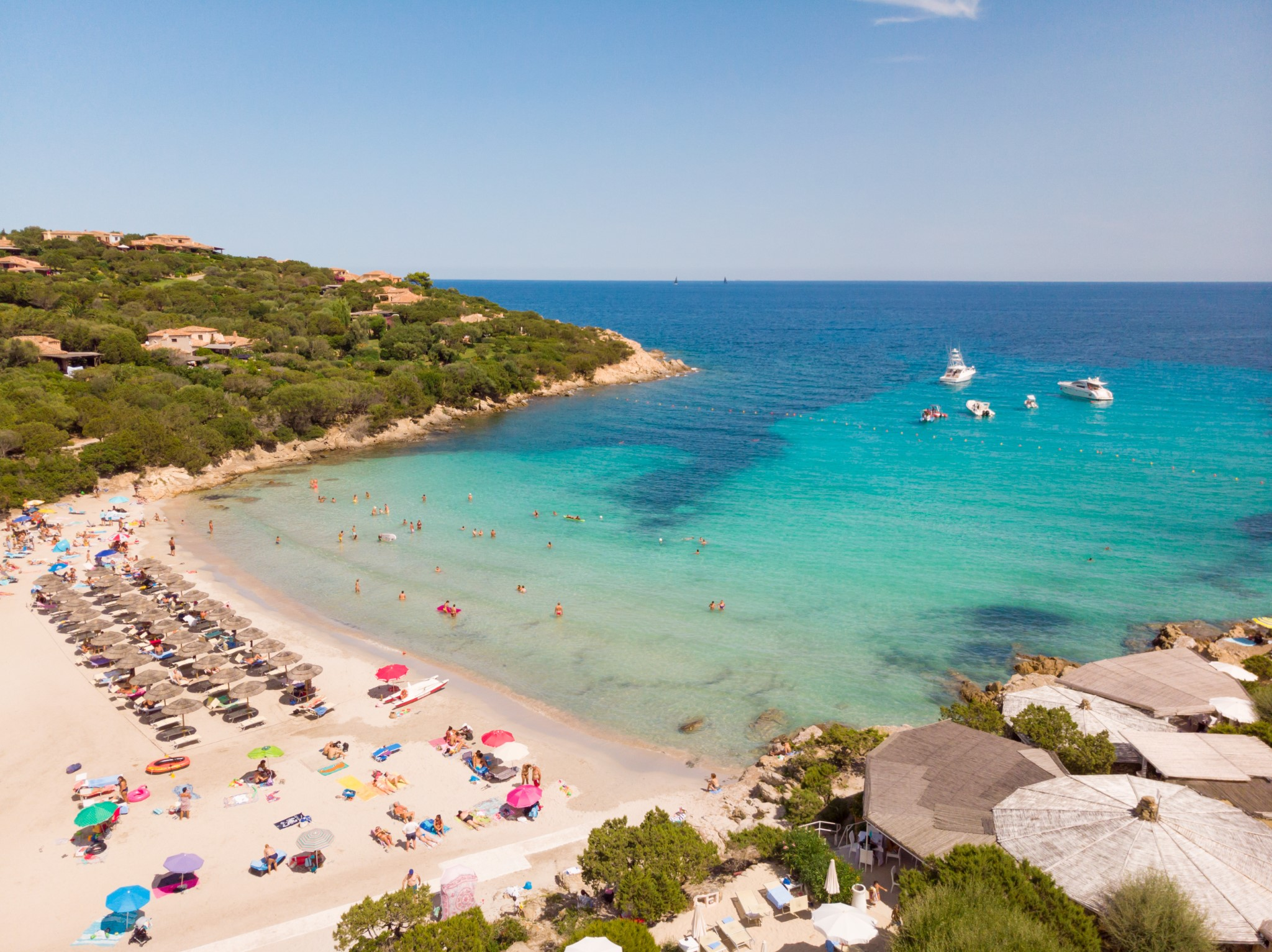 Wonderful turquoise blue colors of the sea of Cala Granu beach, bay near Porto Cervo in Costa Smeralda, Sardinia, Italy.