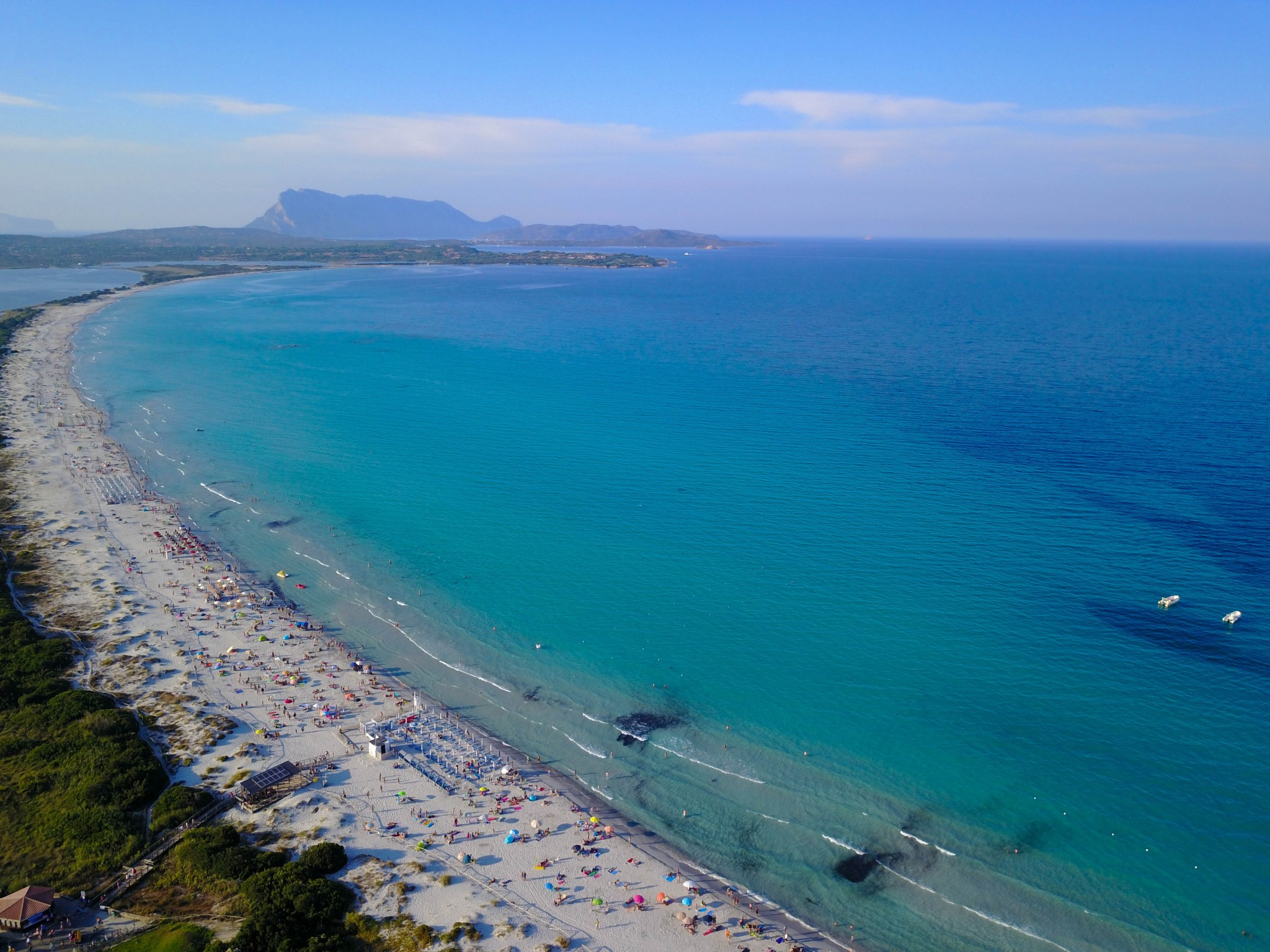 Aerial view. White sand and clear water of the Mediterranean Sea. The famous La Cinta beach. The island of Sardinia. Italy.