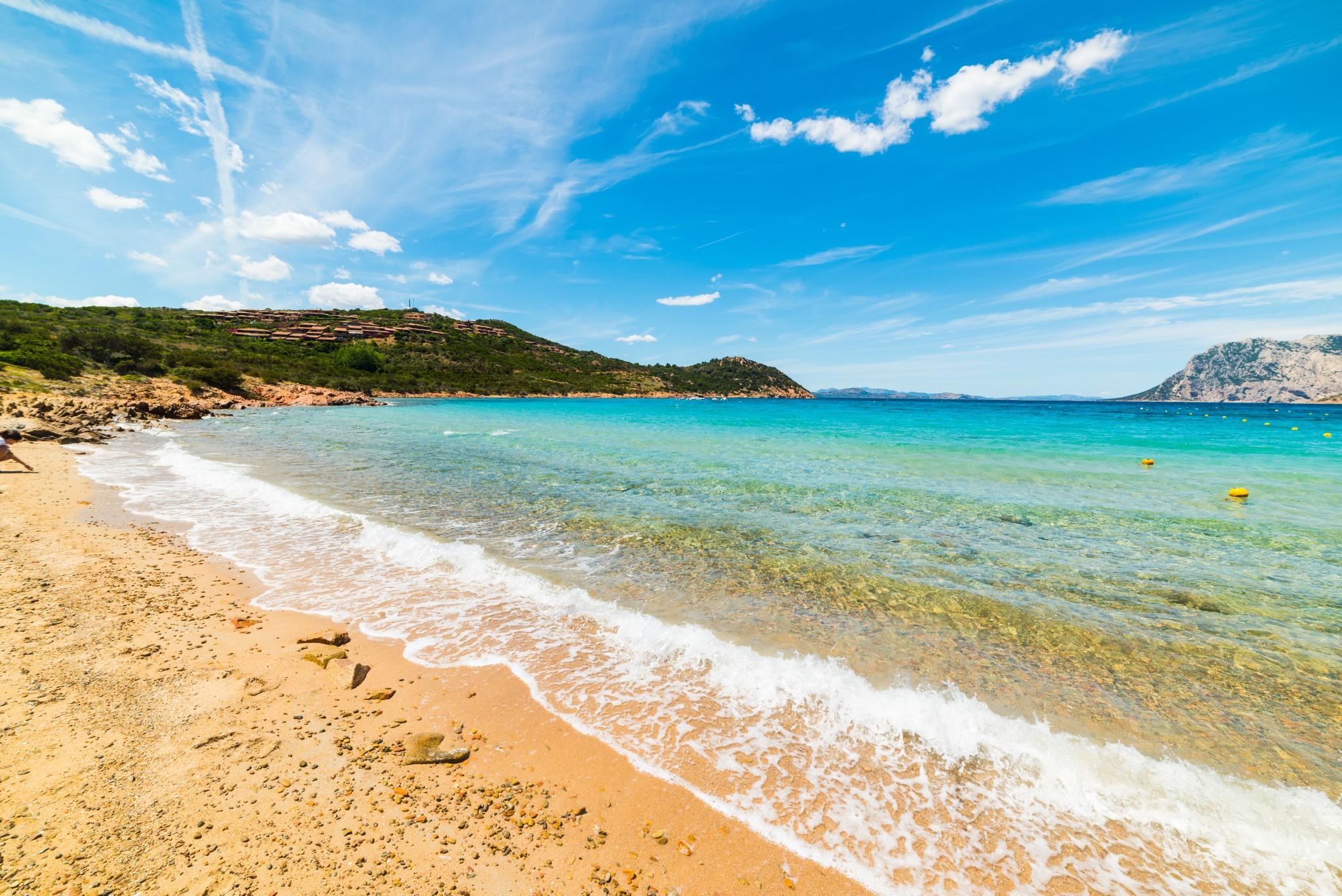 Capo Coda Cavallo shoreline on a clear day, Sardinia