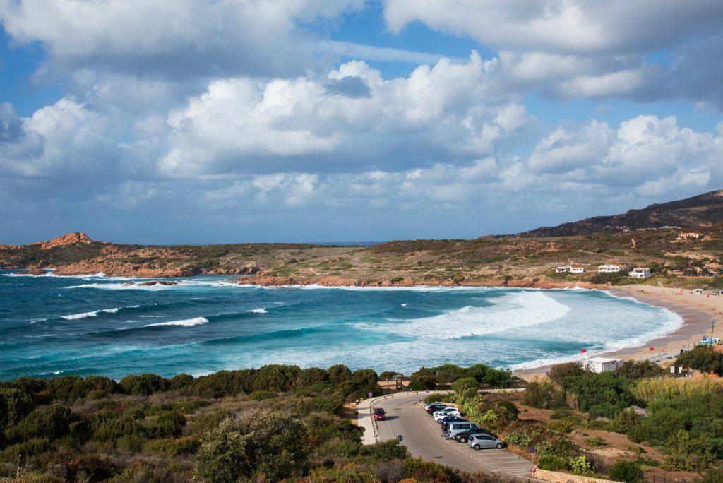 a view of the Spiaggia della Marinedda beach in Isola Rossa, Sardinia, Italy