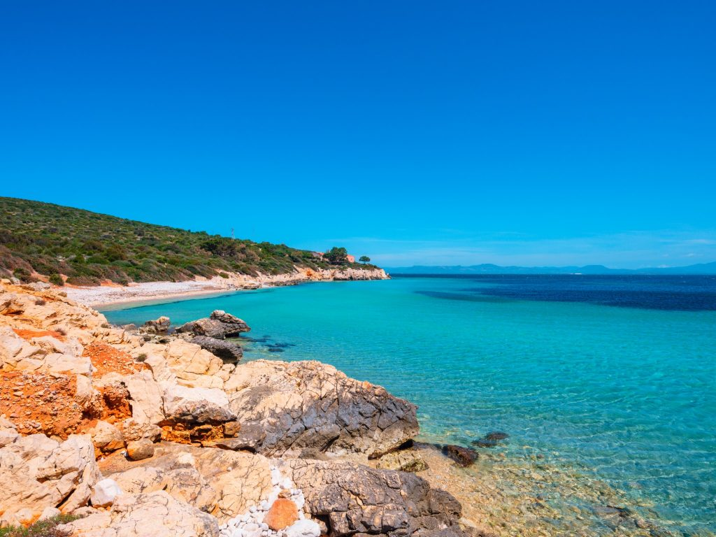 Beach and cliffs of Portixeddu overlooking the turquoise sea of  Sant'Antioco - Sardinia