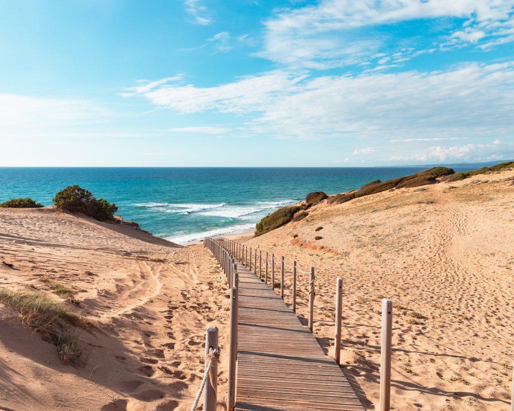 Broad walk over the beach of Scivu, Sardinia, Italy