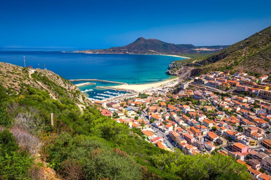 Buggerru town near Portixeddu beach and San Nicolo, Sardinia, Italy. Sardinia is the second largest island in mediterranean sea.