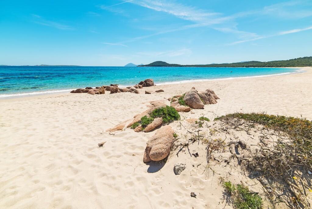 rocks and sand in Liscia Ruja beach in Costa Smeralda, Italy