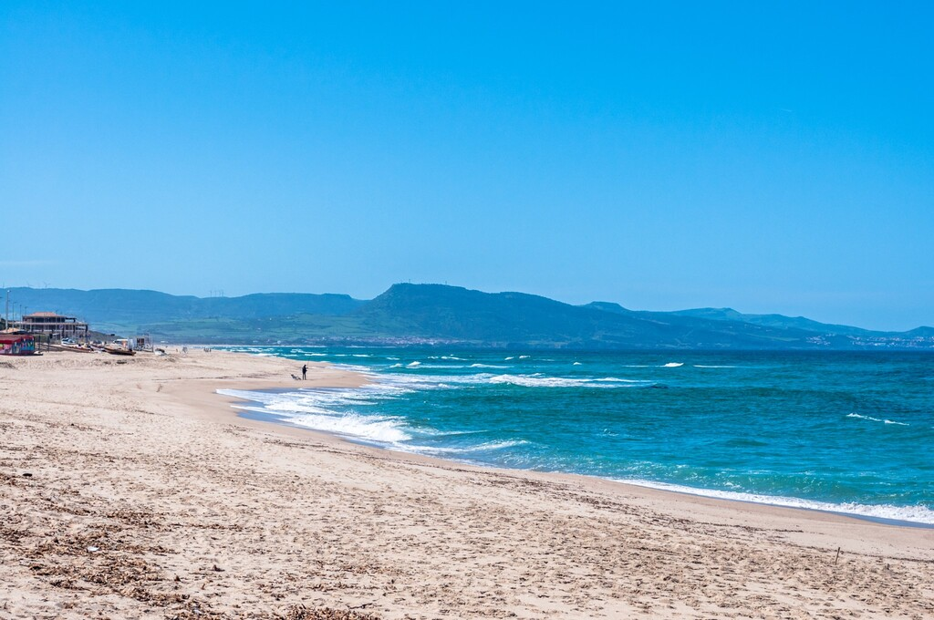 Landscape of desert beach of Badesi in a sunny day of summer