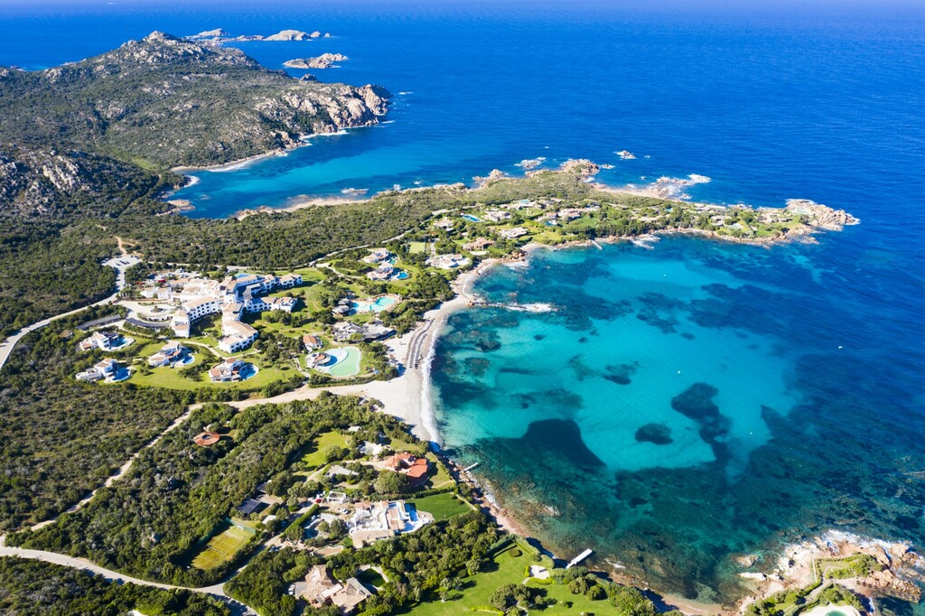 View from above, stunning aerial view of the Romazzino Beach bathed by a beautiful turquoise sea. Costa Smeralda (Emerald Coast) Sardinia, Italy.