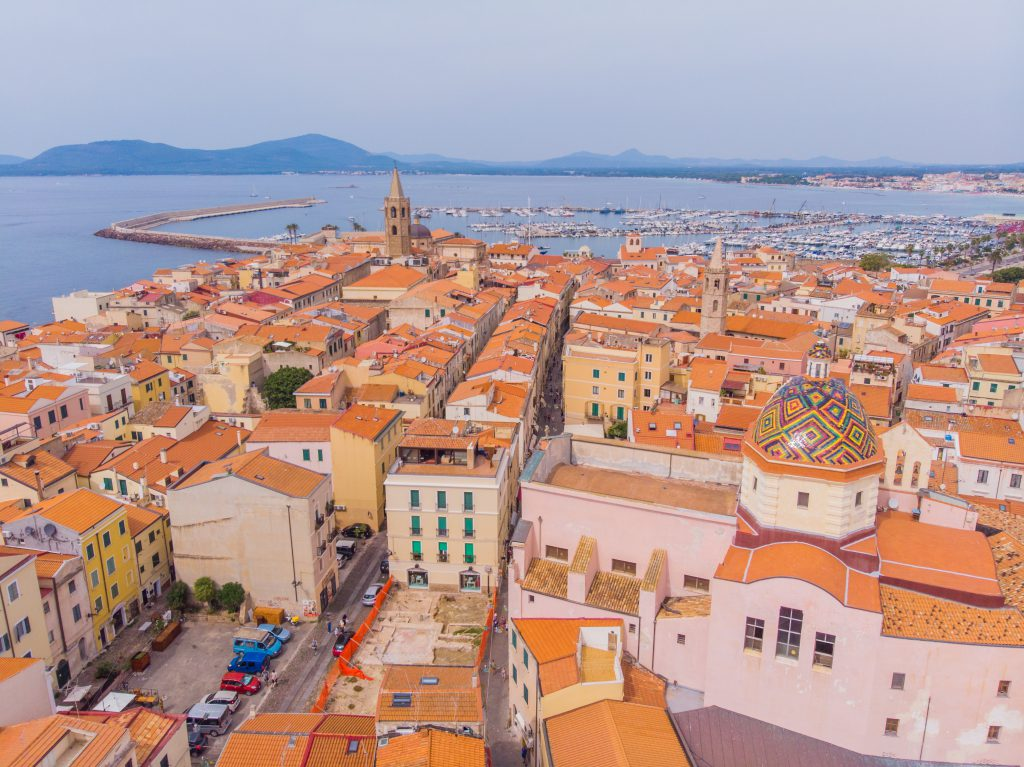 Aerophotography. View from flying drone.Panoramic cityscape of old town of Alghero (L'Alguer), Province of Sassari, Italy, Europe. Spectacular scene of Sardinia island, Mediterranean seascape.Top View