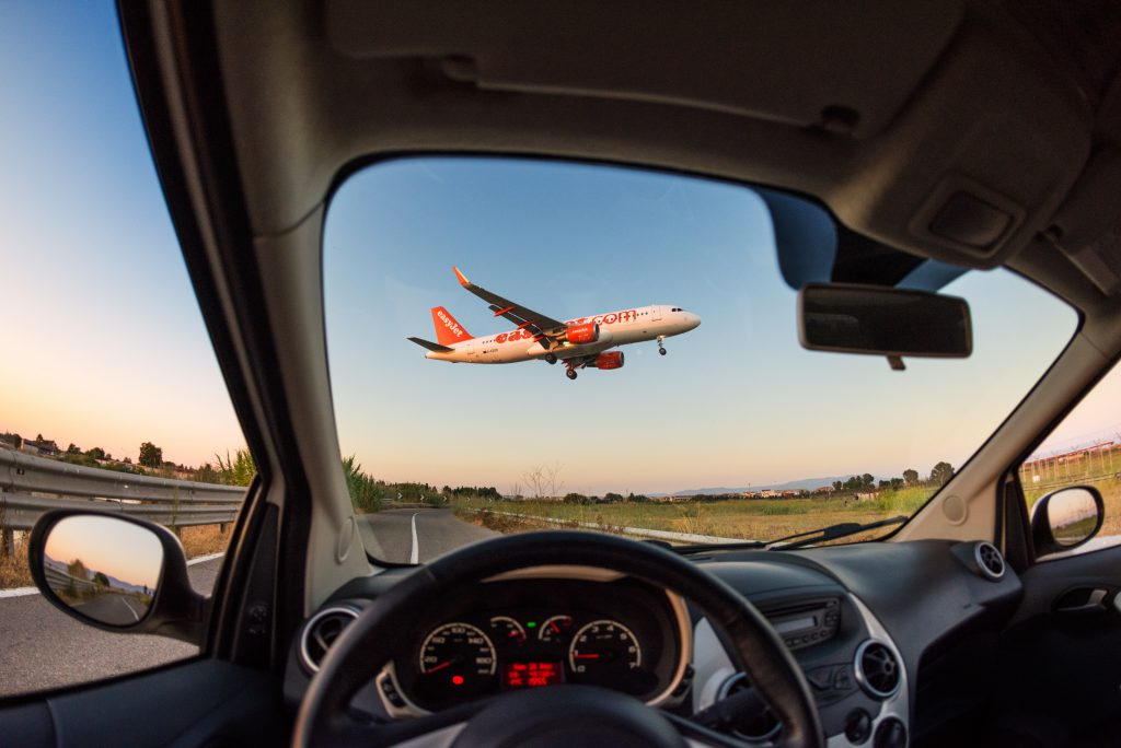 Cagliari, Italy 27/08/2016: EasyJet A320 viewed from inside a car landing on Cagliari Elmas airport