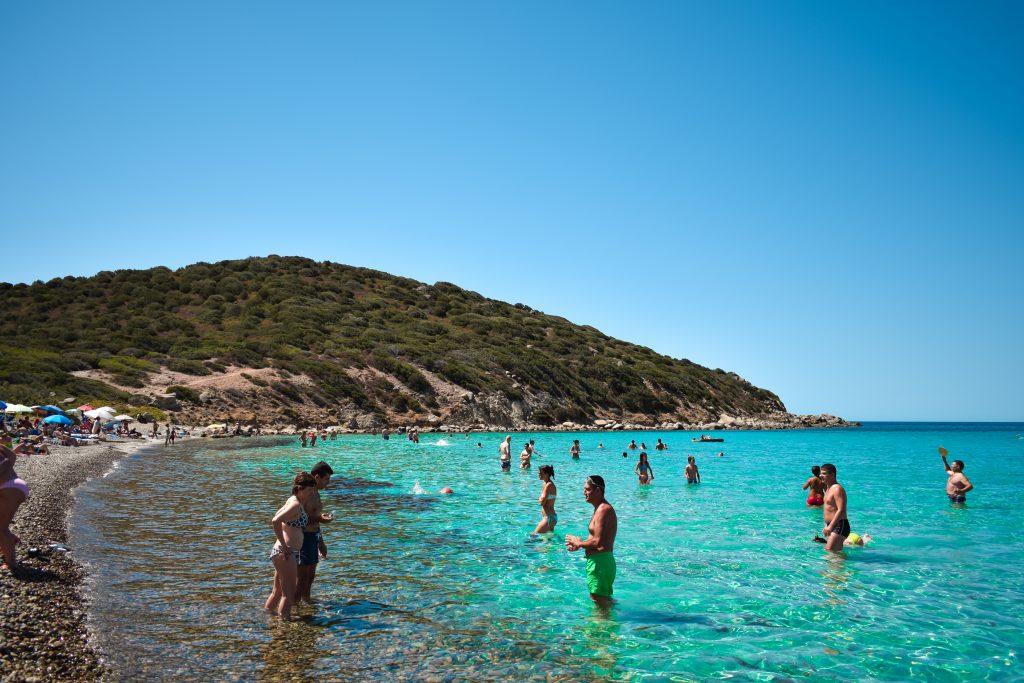 Quartu, Italy, 08/06/2018: People at Mari Pintau Beach in Sardinia