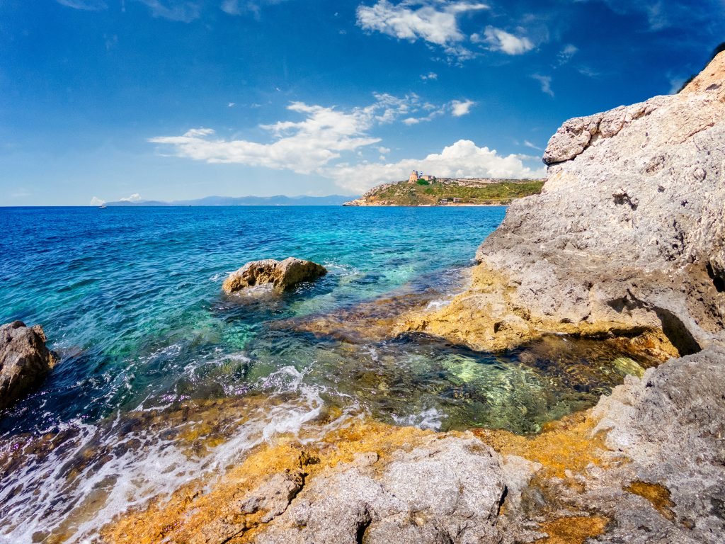 View of the beautiful bay of Calamosca and the Lighthouse of Sant'Elia, Cagliari, Sardinia, Italy.