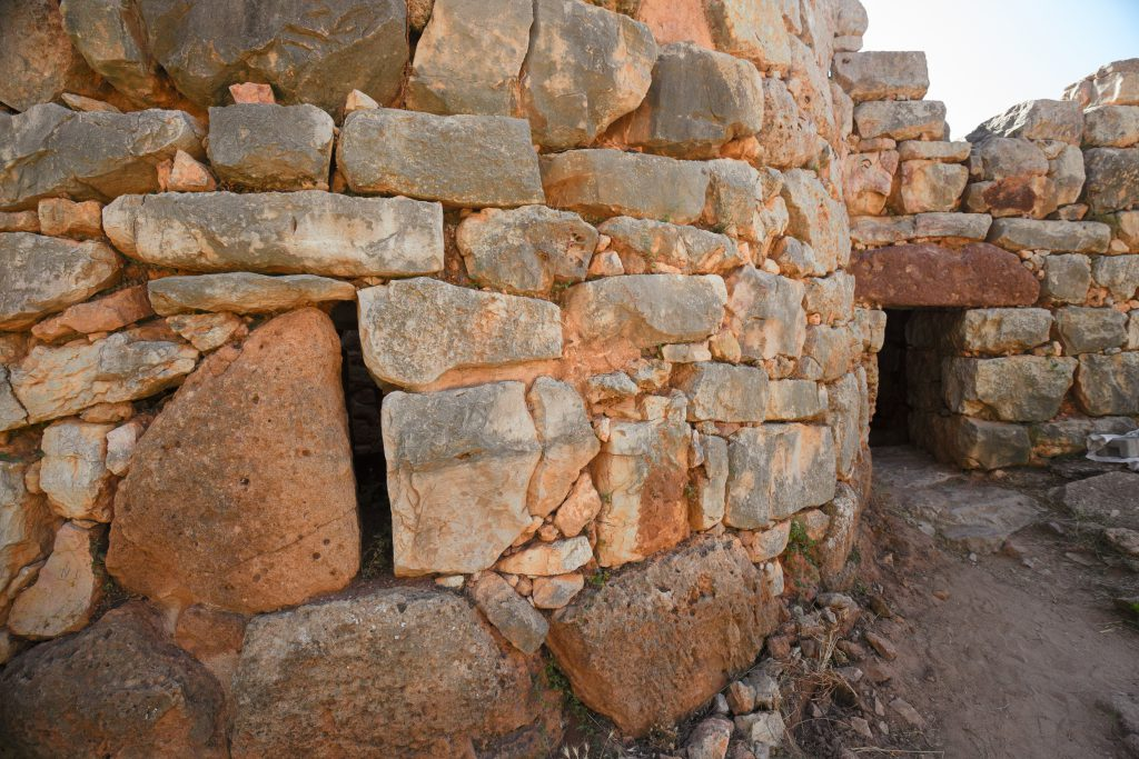 """ALGHERO, ITALY - JULY 21, 2018: View of the archaeological site of the """"Nuraghe Palmavera"""" in Sardinia, Italy."""