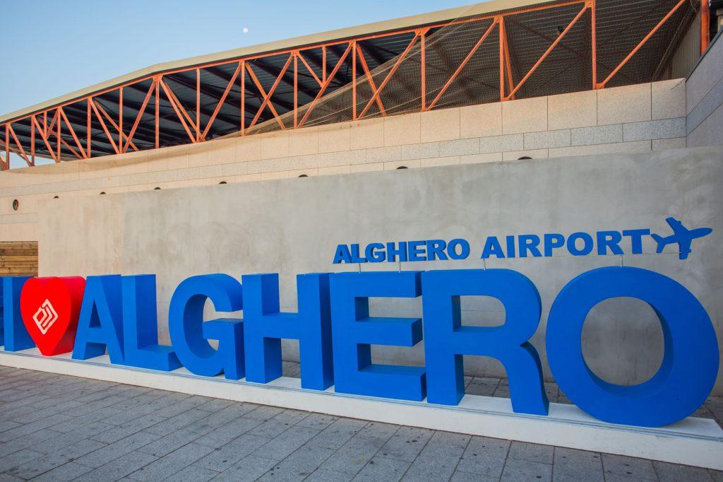 ALGHERO, ITALY - September 17, 2019: Facade of passenger Terminal of Alghero-Fertilia Airport (Alghero - Riviera del Corallo Airport). It is one of the three main airports serving Sardinia island