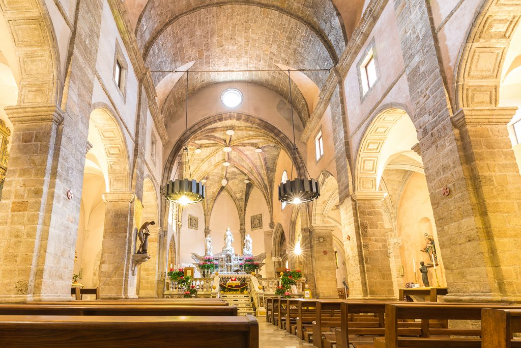 Alghero, Sardinia island, Italy - December 28, 2019: Alghero Cathedral also known as Cathedral of St. Mary in the historic quarter of Alghero