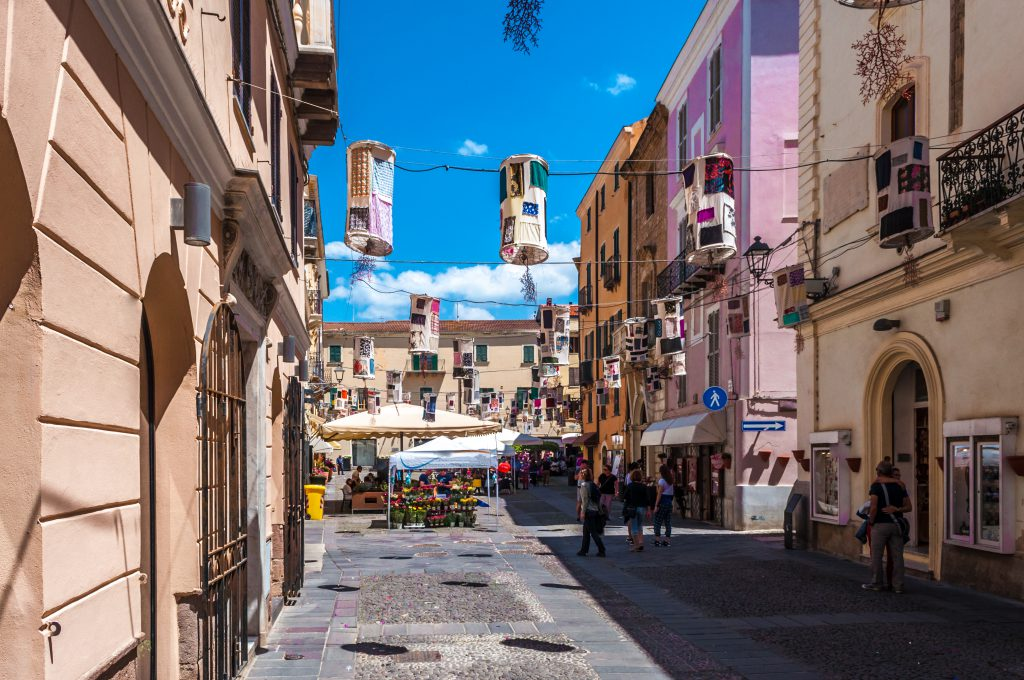 Alghero, Sardinia / Italy - May 12 2018: View of crowded Civic Square in old city of Alghero in spring morning