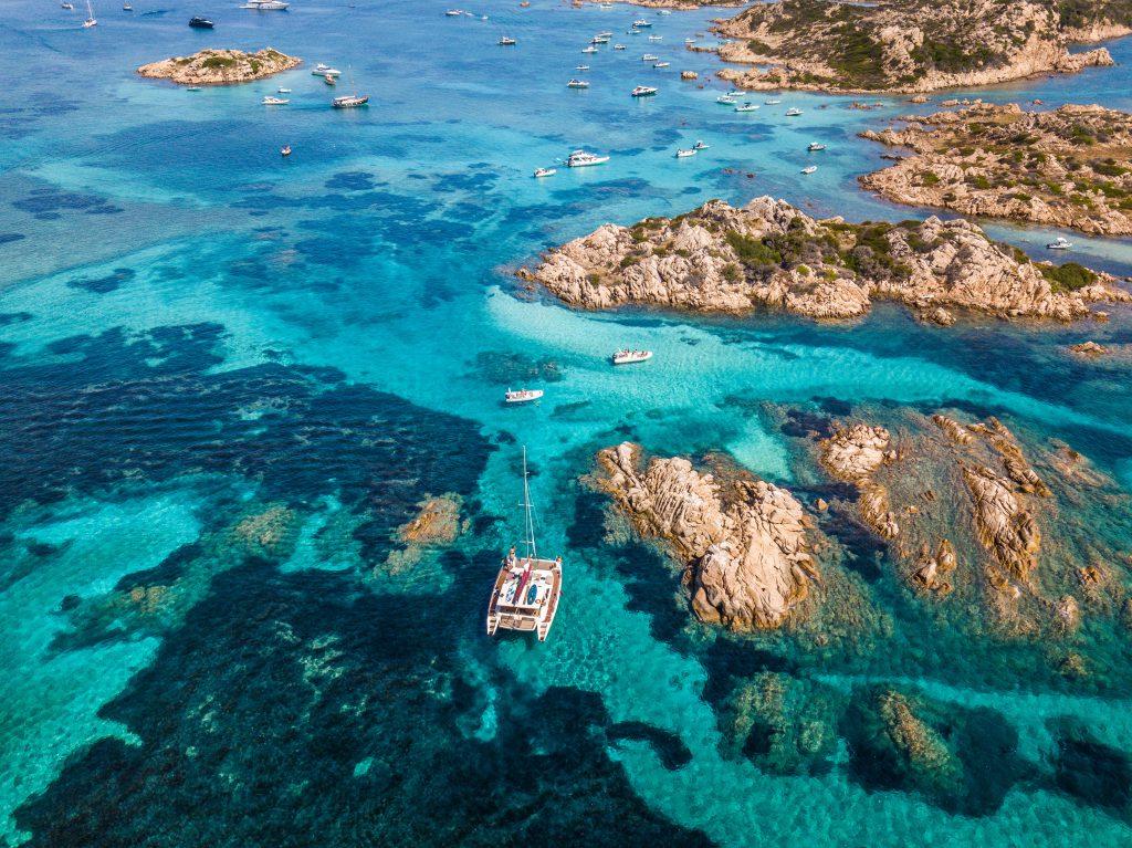 Catamaran in the waters of the Maddalena archipelago, Sardinia