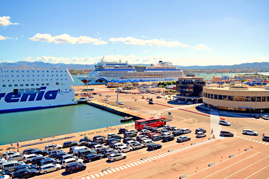 Italy, Sardinia, Olbia, July 2017 view of the port of Olbia with departing ferries and passenger cars waiting to embark during the summer