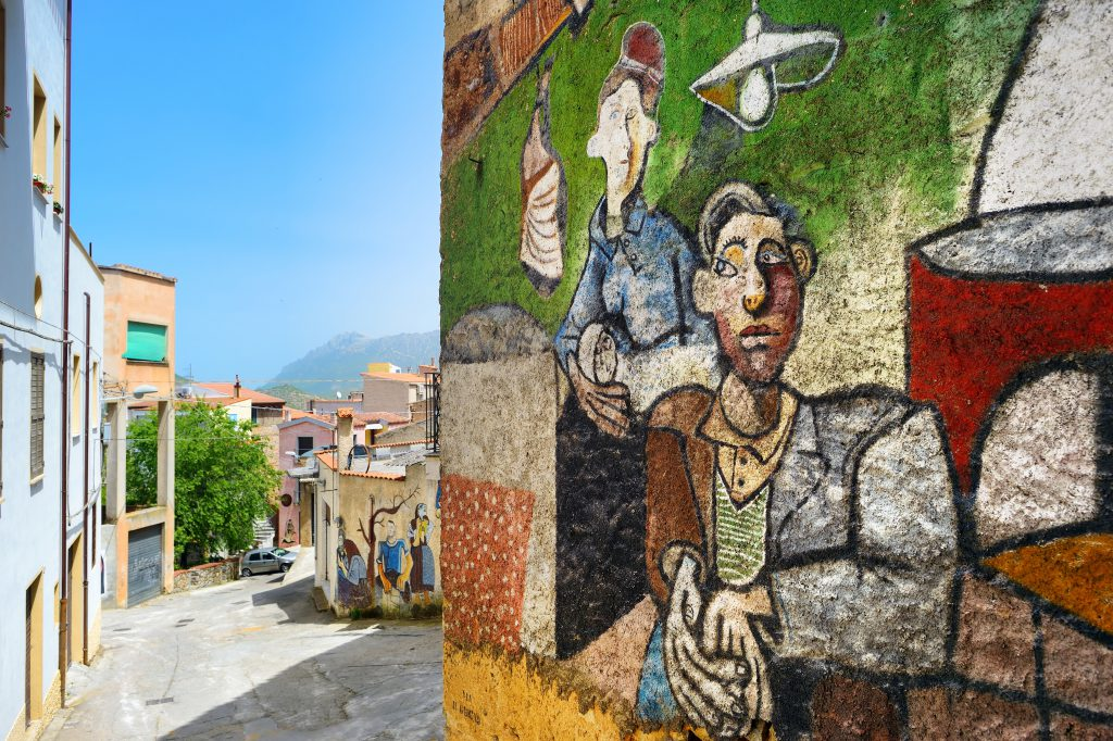 ORGOSOLO, ITALY - MAY 21, 2014: Murals wall paintings about political and historical facts in Orgosolo, Sardinia, Italy