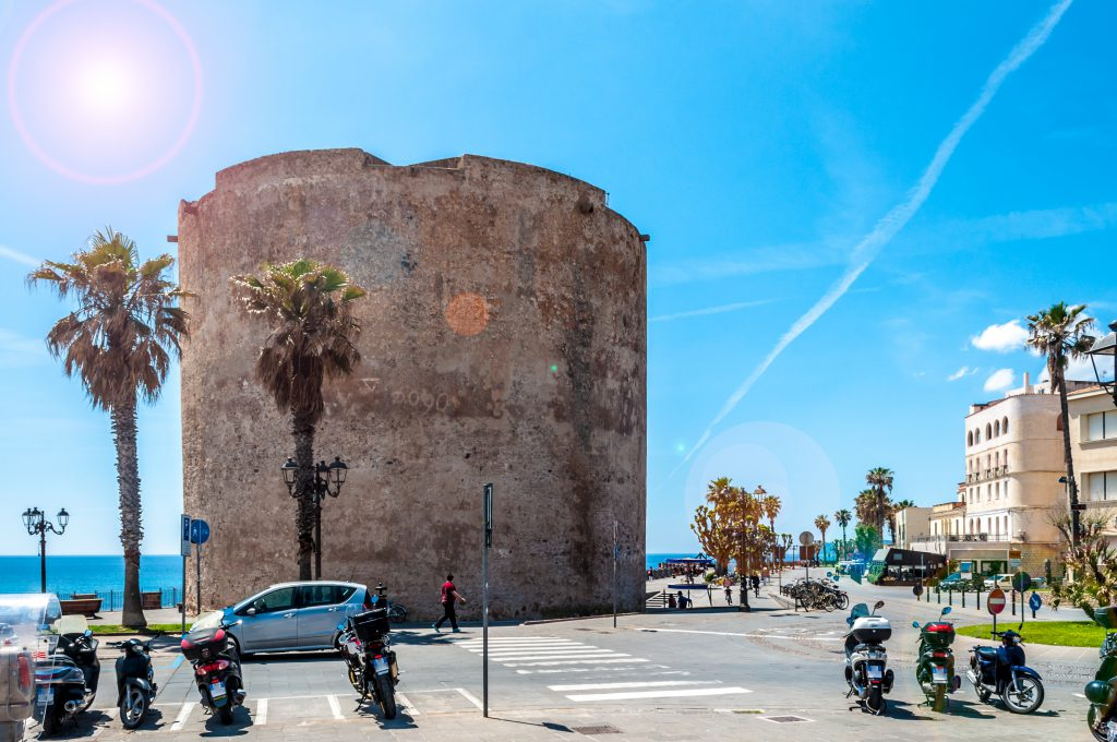pedestrian area on the ramparts near the Sulis Tower in  Alghero - Sardinia in a sunny day of spring