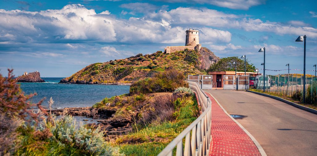 Popular tourist destination - Spiaggia Di Nora. Amazing summer view of Torre del Coltellazzo o di Sant'Efisio tower, Sardinia island, Italy, Europe. Beautiful seascape of Mediterranean sea.