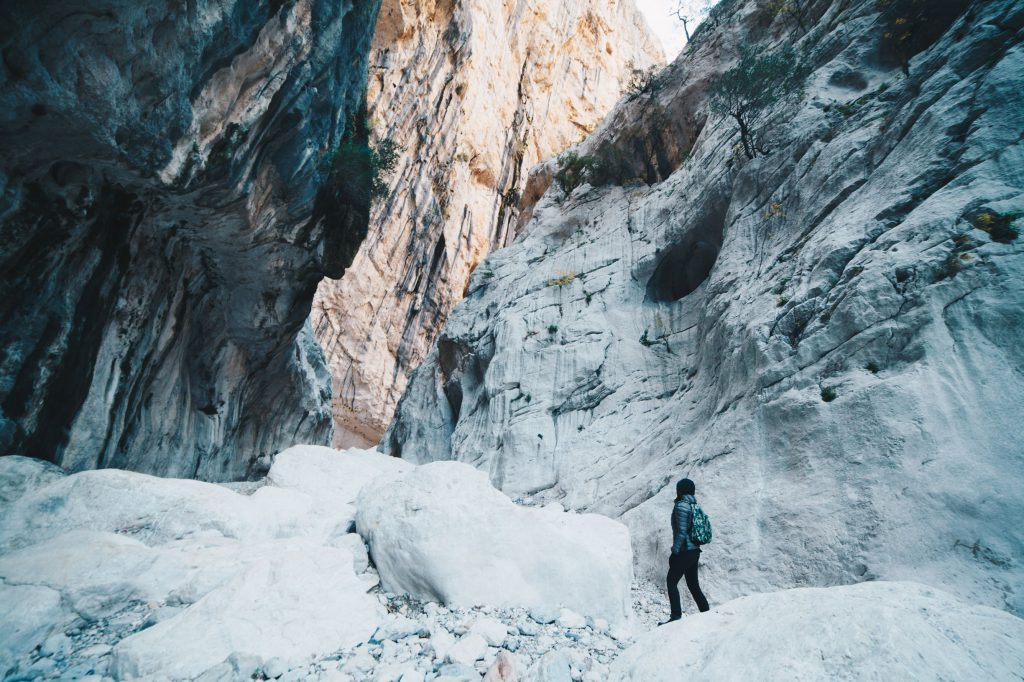 Woman hiking insdide the deepest canyon in Europe - Activity and Health concept - Gola Su Gorroppu.
