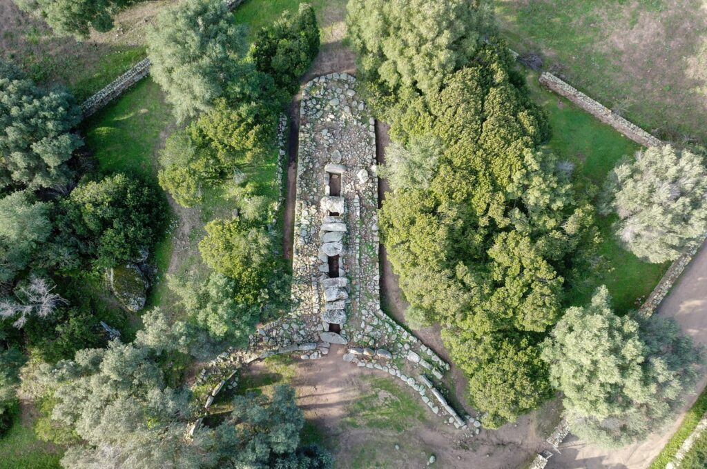 """Aerial view of the Tomb of giants """"Su Mont'e s'abe"""", Olbia, one of the many ancient and mysterious archaeological sites of the beautiful island of Sardinia"""