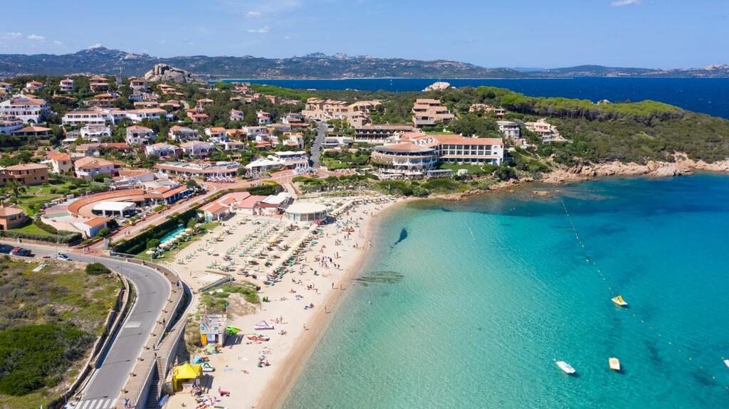 Aerial image of Baja Sardinia beach in Costa Smeralda, Sardinia