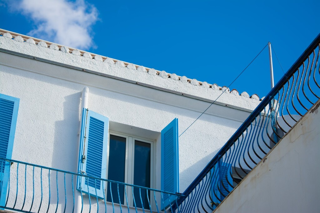 blue window under a colorful sky. Shot in Alghero, Italy